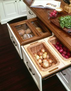 Kitchen-drawer baskets that breathe for root vegetables, onions, garlic and potatoes and glass-enclosed drawers that keep bread fresh. Oh my! | via stylisheve.com