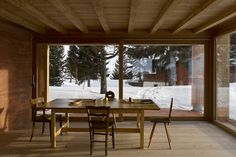 Rothaus | Jonathan Tuckey Design, Andermatt, Switzerland. The re-configuration of an existing house, that challenges the existing pre-conceptions of a swiss chalet. Red pigmented concrete walls, with a larch engineered timber frame structure. all finishes and joinery in larch.