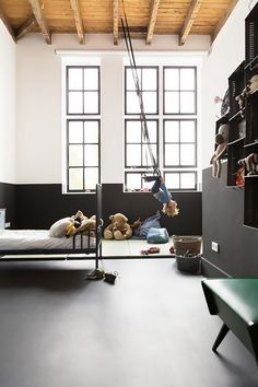 The color-blocking and ingenious flying-trapeze vibe of this edited and organized boys' room is part jungle gym, part iconic cool. If you have the good fortune of lofted ceilings and plenty of...