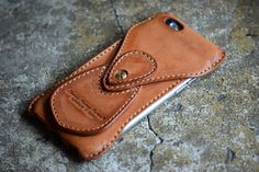 Roberu's Shading Leather Case for the iPhone 6S - held together by a chicago screw