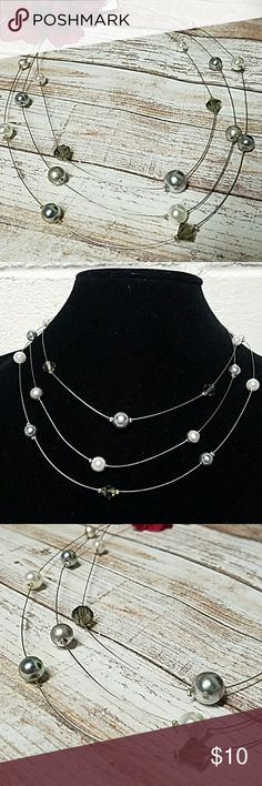 """Floating Crystal & Pearls Triple Strand Necklace Gorgeous Metalic Silver & White Pearls & Smoked Crystals Accent the neckline on this piece. Layers are 14, 16 & 18"""" in length w/a 3"""" extender chain & lobster clasp closure. Very thin silver wire necklace. Item#N904 *ALL JEWELRY IS NWT/NWOT/UNUSED VINTAGE* 25% OFF BUNDLES OF 3 OR MORE ITEMS! **REASONABLE OFFERS ACCEPTED** BUY WITH CONFIDENCE~TOP 10% SELLER,FAST SHIPPER, 5 STAR RATING, FREE GIFT w/MOST ORDERS! Jesi's Fashionz  Jewelry Necklaces"""
