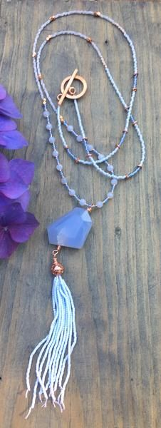 Beaded necklace with blue lace agate & copper, beaded tassel andtoggle clasp