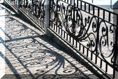 Wrought iron fence designs and chandelier. Decorative wrought iron work for home. Brackets, gates, fences and wall decor.