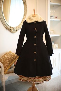 Classic lolita coat It could be a normal coat, but it is really cute  so it's the perfect mix if you don't want to stand out too much!:)