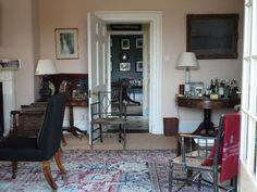 like that black chair in trad English sitting room / From North Norfolk Coastal - Ben Penreath