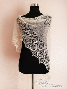 This is a triangular lace shawl, knitted from the top down. The increases are made on both sides of the central stitch and along the edges of the shawl in each odd row.