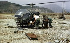 A helicopter delivers a wounded soldier from the front lines to the 8063rd MASH unit, stationed 10 miles away, during the Korean war.