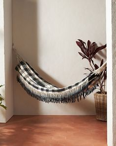 Having a great hammock or a swing in your backyard is cool, but putting one up inside your home? Now that's a refreshing way to give a new meaning to hanging out. There's something extra cozy (not to mention totally chic) about indoor hammocks and hanging chairs—it's like you can just curl up and float on cloud nine right there in your living room. No matter what your style is, from rainbows to macramé, there's a hanging retreat for everyone on this list. Indoor Swing, Indoor Hammock, Hammock Chair, Hammocks, Hanging Chairs, Hanging Out, Cozy Family Rooms, What's Your Style, Outdoor Furniture