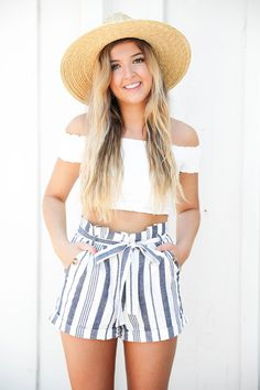 White off the shoulder crop top from Showpo paired with my favorite striped blue tied shorts from Nordstrom! I paired this look with a wide brim straw hat and my favorite Marc Fisher Espadrille wedges! This cute summer outfit is going to be on repeat! Details on fashion blog daily dose of charm by lauren lindmark