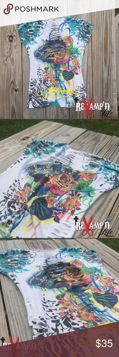 Custom cut up weave Ed Hardy stretchy lowcut shirt ☠✂️ReVamp'D Life CLothinG✂️☠ •••  Ask for bundles to save $$ ••• always accepting offers!  •••  • ✂️ ---> Custom revamped ED HARDY shirt [cut, weave, embellished]. Very bright and stretchy. Somewhat low cut.  • ☠ ---> Size small/medium  #edhardy #christianaudigier #buckle #affliction #rhinestone #embellished #bling #bright #stretchy #colorful #lowcut #comfortable #schoolshopping #sale #style #revamped #reconstructed #restyled #reworked…