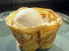 Crepes Suzette with Vanilla Ice Cream and Orange Butter Sauce