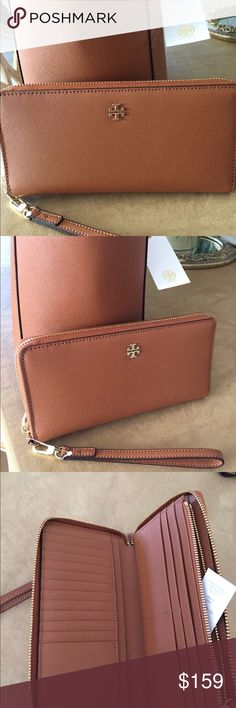 Tory Burch YORK Zip Passport Continental Wallet. Beautiful YORK zip passport continental wallet in luggage color Saffiano leather. This wristlet/wallet can hold your IPHONE. PLUS in a large pocket on the inside behind zip coin area. Can hold 16+ credit cards, passport, business cards etc. Zip around closure.... New with tags, never used. Tory Burch Bags Wallets
