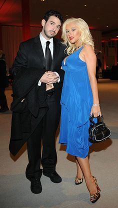 Christina Aguilera wearing Christian Louboutin Leopard Peep-Toe Platform Pumps, Christian Dior Detective Zipped Bag in Black and Balenciaga Layered Draped Dress.