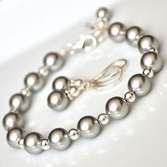 Hey, I found this really awesome Etsy listing at https://www.etsy.com/listing/85630781/silver-bridesmaid-jewelry-set-grey-pearl