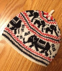 Free Knitting Pattern for Elephant Hat - Child sized colorwork beanie with elephant motifs. Designed by Kathleen Taylor.Pictured project by harpknit