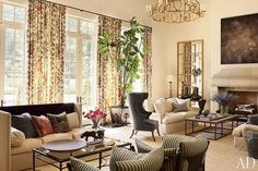 Suzanne Kasler house featured in Architectural Digest - FR accents, table and chair shapes, fireplace.
