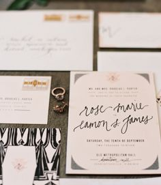 Close-up of invitation suite with modern motif and funky script font (source: rock paper scissors)
