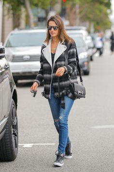 Alessandra Ambrosio Leather Shoulder Bag - For her arm candy, Alessandra Ambrosio chose a black Tod's Double T perforated leather bag.