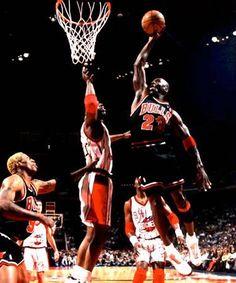 michael jordan slam dunking on Hakeem The Dream Olajuwon