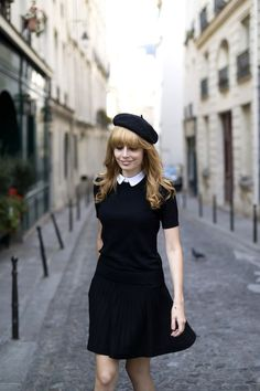 beret with hair down, white collar, black pleated skirt, black short sleeve sweater