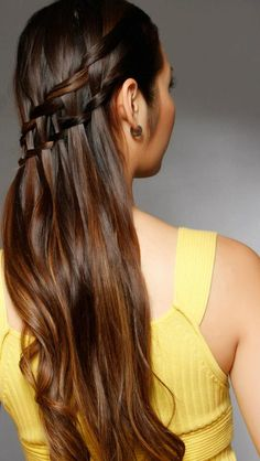 Kieu creates a dramatic look with a braid on smooth hair.  — at Kenneth's Studio for Hair Garden District.