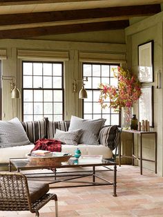 Classic Country Rooms: From tried-and-true blue-and-white palettes to vintage collections and creative repurposing, country decorating never goes out of style. Choose from a variety of lived-in, cozy looks and add comfort to every room of your house. Comfortable Style:   Comfort is a hallmark of country decorating, meaning you don't have to be a slave to a specific style when decorating a room. This three-season porch is the perfect example of how mixing styles can create a relaxing space. The combination of a modern metal coffee table and daybed, tile flooring, and striped cushions is eclectic yet welcoming.