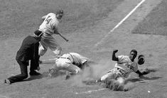 May 17, 1949 at Wrigley Field: Brooklyn Dodger Hall of Famer Jackie Robinson is tagged out by Chicago Cubs catcher, Rube Walker  trying to steal home in the top of the 8th inning as Gil Hodges (#14) looks on.  The Dodgers would beat the Cubs 8-5 in 11 innings.