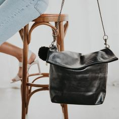 This polished leather, cross body bag is both versatile and functional. It features the classic MC combination hardware and leather removable strap. It has a sleek structured style when folded or leave it open for a casual look. FEATURES Internal zip pocket Two internal patch pockets Key clip Limited edition key ring a Key Rings, Casual Looks, Cross Body, Dust Bag, Crossbody Bag, Hardware, Pockets, Zip, Classic