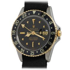 Rolex Stainless Steel and Yellow Gold GMT-Master Wristwatch circa 1977 Ref 16750 | From a unique collection of vintage wrist watches at https://www.1stdibs.com/jewelry/watches/wrist-watches/
