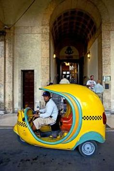 Much cheaper than regular taxis in Cuba, Cocotaxi is like an auto rickshaw with three wheels, a fiber glass body and two seats.