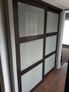 Modern closet doors - Tempered Frosted Glass Composite Espresso Interior Sliding Door at The Home Depot