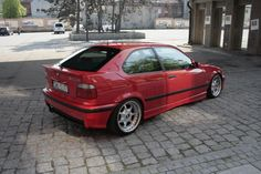 Hellrot M-packet BMW e36 compact on OEM BMW styling 19 wheels