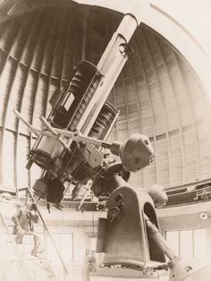 Male Astronomer and Early Observatory Telescope