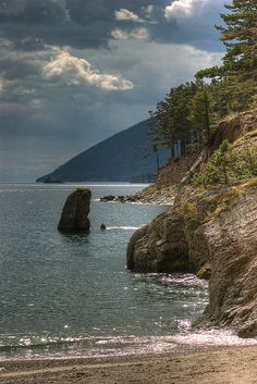 Late afternoon at a sandy cove south of Peschanaya Bay, Lake Baikal, Siberia, Russia.