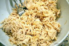 Making a huge batch of shredded chicken in the slow cooker. Organic VT chicken, homemade stock, salt+pep, bay leaves, garlic, cumin. 4 hours @ high temp. Use for salads, wraps, enchiladas, taquitos, and noodle soup.