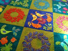 detail of a lovely appliquéd quilt, from the quilts of love blog