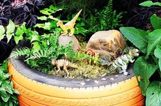 Dinosaur Garden kids play garden imagination dinosaur ideas create tire