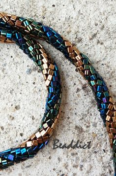 Twisted bead rope necklace. designed and beaded by Beaddict. Herringbone, triangle beads.