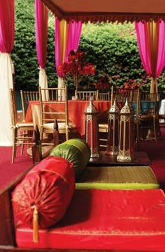 a pink, red and green Moroccan patio with lanterns, bright pillows and curtains Moroccan Party, Moroccan Theme, Moroccan Style, Moroccan Design, Indian Style, Indian Party Themes, Indian Theme, Living Colors, Bright Pillows