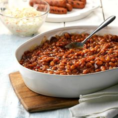 New England Baked Beans Recipe -For a potluck or picnic, you can't beat this classic side that starts with a pound of dried beans. Molasses and maple syrup give it a slight sweetness. —Pat Medeiros, Tiverton, Rhode Island