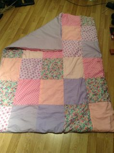 Purple and pink baby quilt (with view of other side)