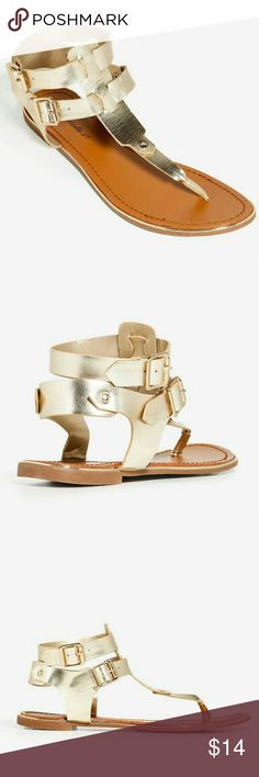 "COMING SOON! Jovie-32 Summer Sandal New with Box A minimalist thong sandal with a high shine metallic gold upper, double buckle ankle strap and cage counter. Flat dome stud accents. Cushioned insole. Low flat heel.  1/4"" approx. heel height Breckelles Shoes Sandals"