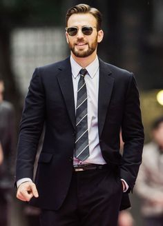 Chris Evans - suit, grey and white striped tie, sunglasses.