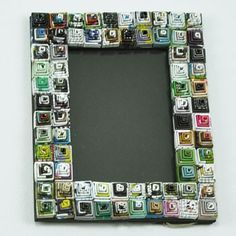 we just love these! Spiral Recycled Magazine Photo Frame $16