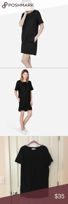 Everlane black cotton pocket dress Gently worn / features set-in sleeves, two oversized chest pockets, and a two on-seam pockets at the hip Everlane Dresses