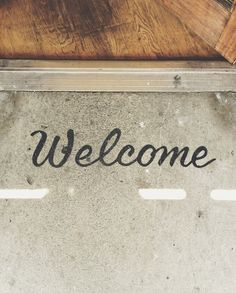 Alternative welcome mat.  Painted onto cement.  Kind of hart to see, but very cool!