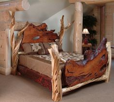 """This is a statement bed. This rustic log bed screams """"Wow"""". The incredible solid slabs of live edge redwood or burl wood tell a story by themselves.  But when combined with the twisted juniper logs - each piece placed in just the right spot to support the free form shaped slabs - it becomes"""