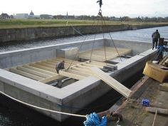 Dirkmarine produces custom designed floating homes in UK on a maintenance free concrete hull HUBB®. Approved by strictest Scandinavian authorities. Floating Architecture, Houseboat Living, Water House, Student House, Floating House, Floating Dock, Tiny House Movement, Affordable Housing, Wooden Boats