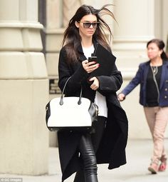 Black and white: For her day of castings Kendall opted for a monochrome ensemble...
