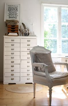 Gorgeous white drawers and chair!